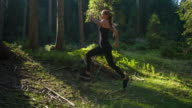 Female athlete running in the woods