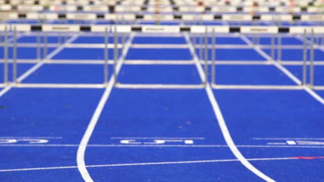 MS SLO MO Female Athletes in Hurdle Race