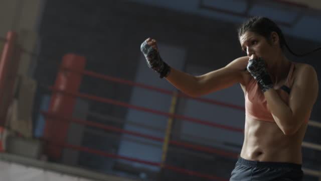 Female boxer preparation to fight