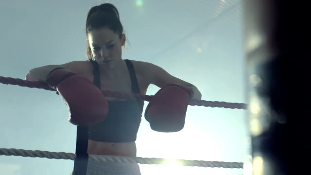 MLS Female Boxer rests in the Boxing Ring.