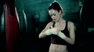 Female Boxer training in Boxing Club.