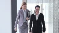 SLO MO Female business colleagues shaking hands in hallway