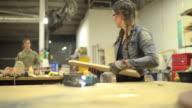 Female carpenter working on wood - DOLLY SHOT