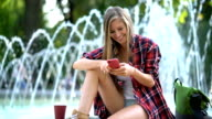 Female chatting on the phone, smiling and having fun