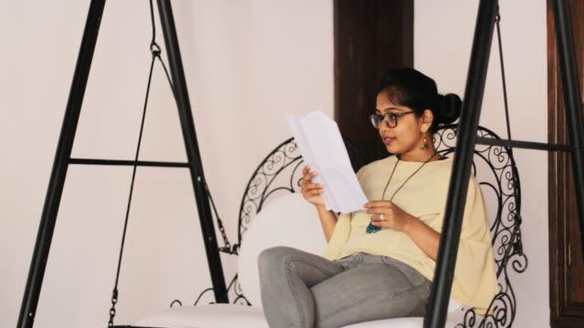 Female Checking Document