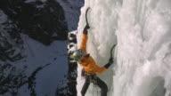 MS Female climber climbing ice using hooks, Eidfjord, Hordaland, Norway