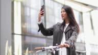 Female cyclist taking a selfie