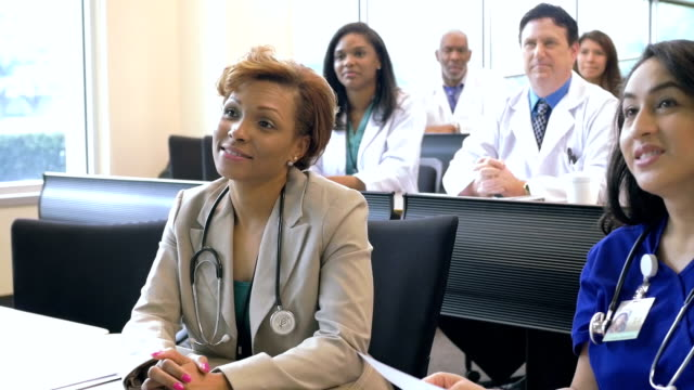 Female doctor answering question during healthcare conference or seminar