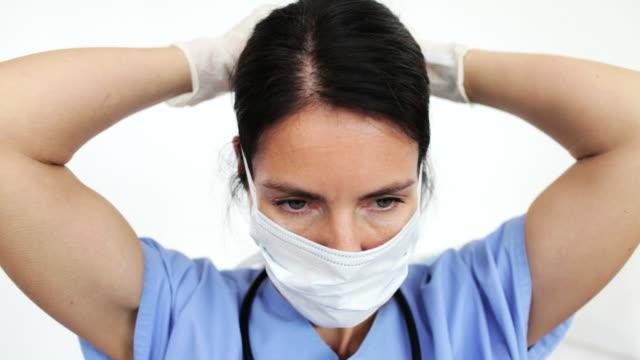 Female doctor getting ready