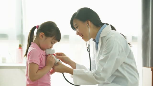 MS female doctor giving a young child a check up