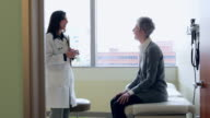 MS Female doctor in discussion with mature female patient in exam room/Seattle, Washington, USA