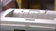 CU, TD, Female doctor printing prescription in office