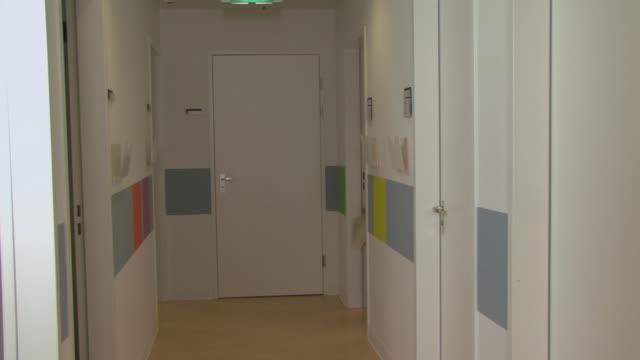 MS Female doctor walking through hospital corridor / Helmond, North Brabant, Netherlands