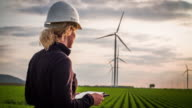 Female engineer inspecting wind turbines - Women in STEM