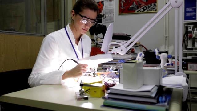 Female engineer repairing drone