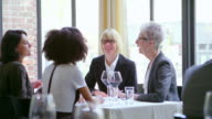 MS female executives having business lunch meeting in restaurant.