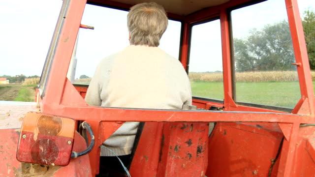 HD: Female Farmer Driving Tractor
