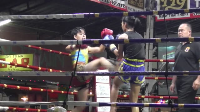 Female fighters compete in Muay Thai boxing at Thaphae Boxing Stadium in Chiang Mai