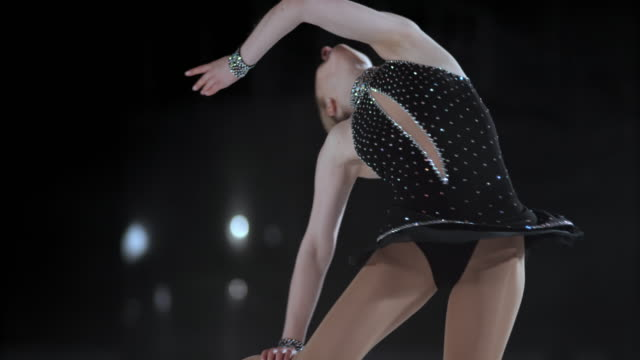 SLO MO TU Female figure skater in elegant layback spin