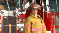 MS PAN PORTRAIT Female fire fighter in uniform in fire station/ Richmond, Virginia