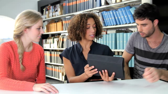 Female giving presentation on ipad