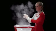 SLO MO Female gymnast clapping wrapped hands over chalk bowl