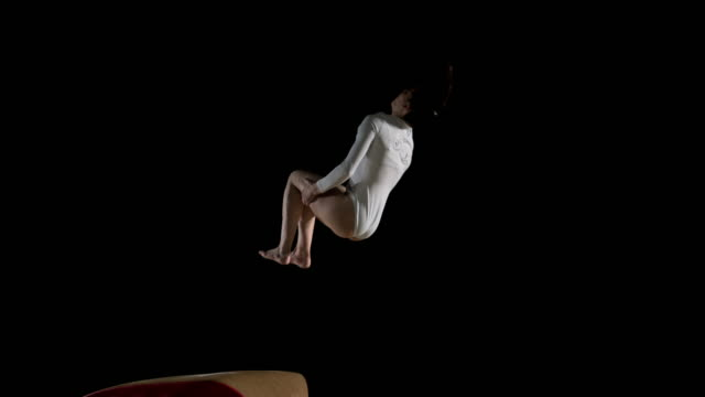 SLO MO DS Female gymnast performing her routine on the vault