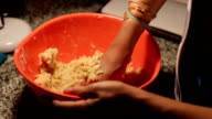 female hands in flour closeup kneading dough