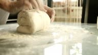 female hands making yeast dough