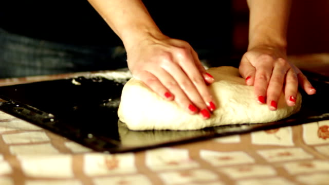 Female hands preparing bread