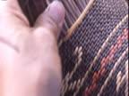 Female hands weave basket Venezuela