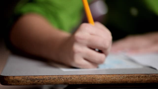 Hands of female student taking test