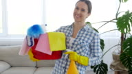 Female holding bucket with cleaning supplies