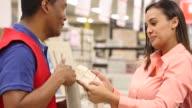 Female homeowner talking to home improvement salesman