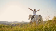 SLO MO Female horse rider enjoys the freedom in nature