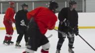 Female ice hockey player scoring goal and celebrating