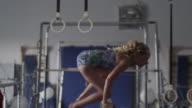 MS TU Female instructor assisting girl (10-11) exercising on balance beam, Orem, Utah, USA