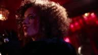 Female jazz singer in bar.