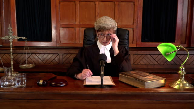 4K DOLLY: Female Judge in Court listening to case