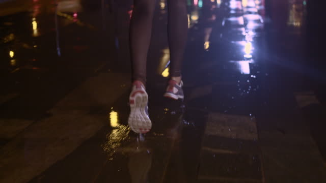 SLO MO TS Female legs jogging in the city at night