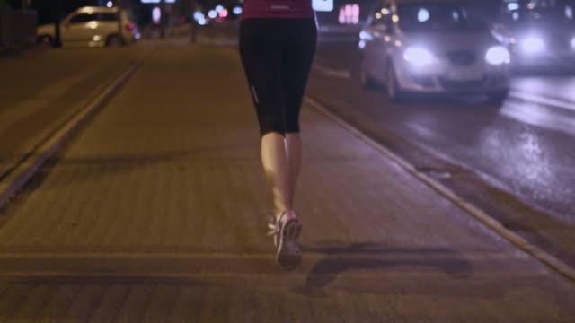 SLO MO TS Female legs running through the city