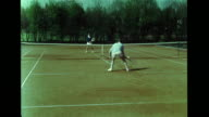 Female male playing tennis on grass court hitting ball w/ racquets REVERSE FILM Game play girl walking backward off court Tennis couple in Mercedes...