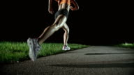 SLO MO PAN Female marathon runner running at night