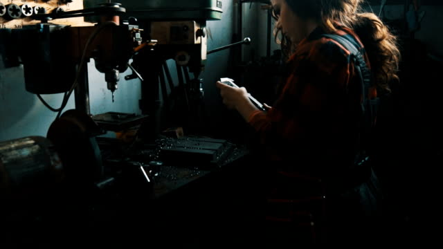 Female mechanic at workshop