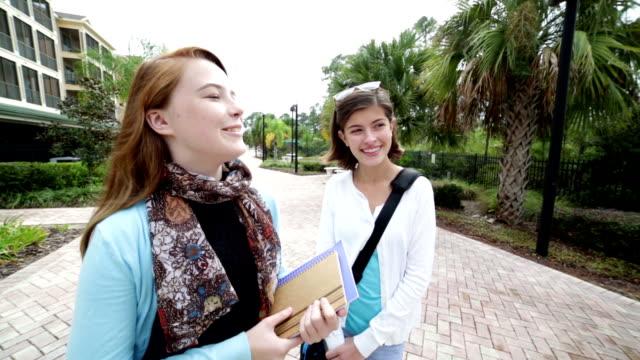 Female middle school students walking after school