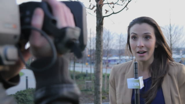 Female news reporter on location