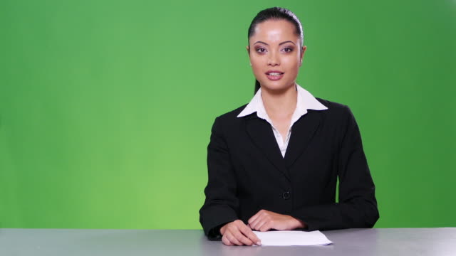 4K Female newscaster on green background