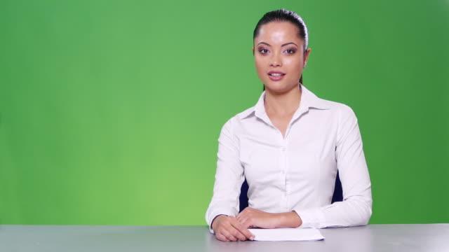 4K Female newsreader on green background
