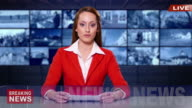 4K Female newsreader with red suit  in television studio