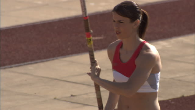 MS PAN Female pole vaulter running with pole/ Sheffield, England
